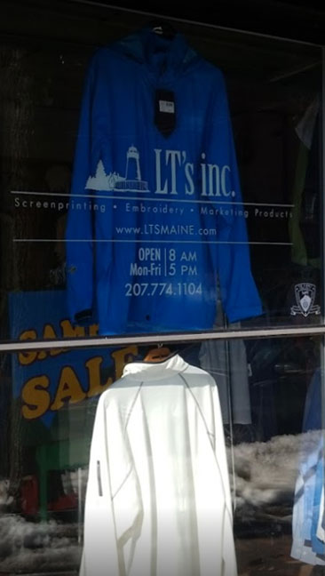 LT's inc.'s lighthouse logo lets you know you're at our storefront in Portland, Maine.